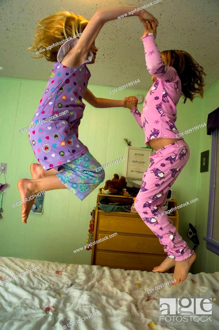 Stock Photo: Jumping on a bed.