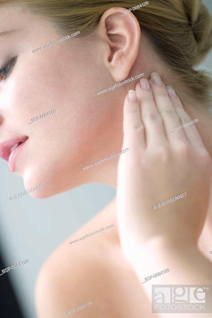 Stock Photo: WOMAN PALPATING LYMPH NODE Model.