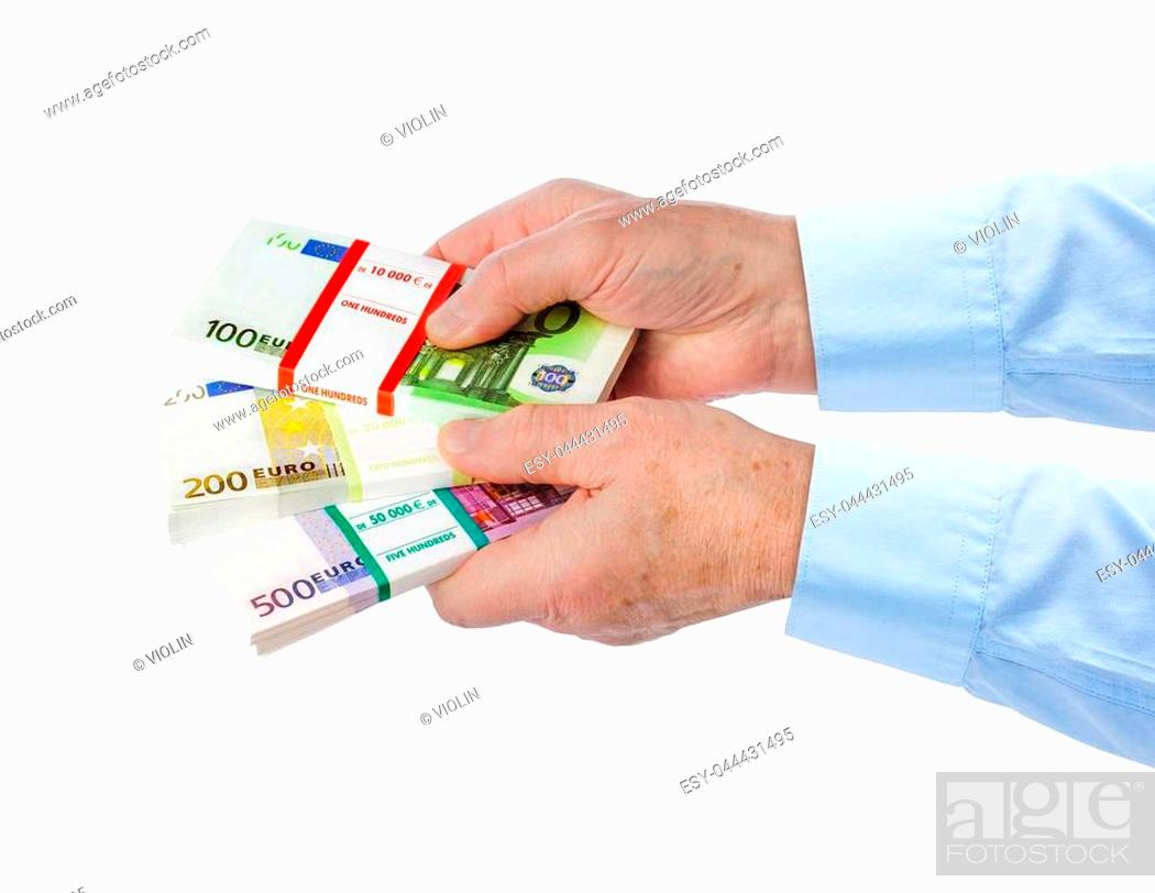 Stock Photo: Hand with money isolated on white background.