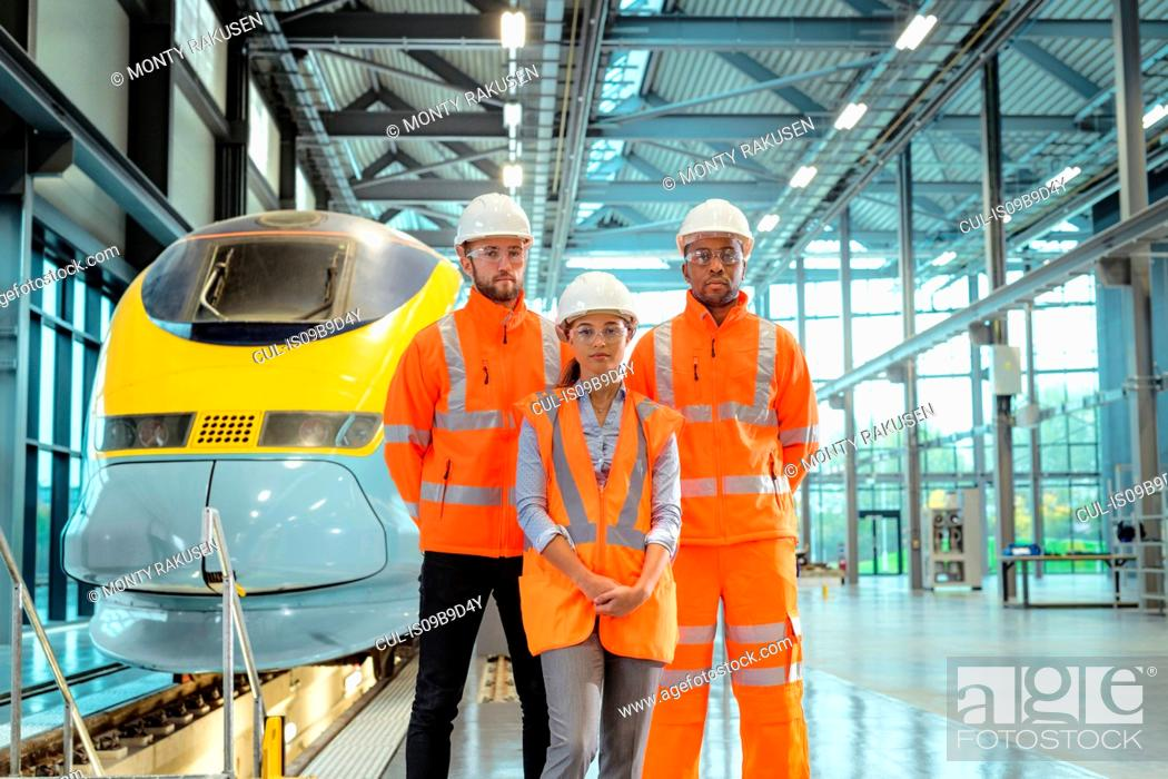 Stock Photo: Group portrait of apprentices at railway engineering facility.