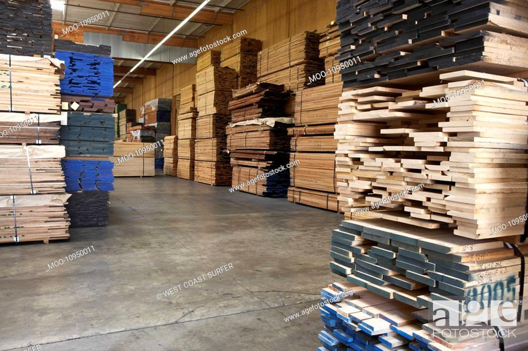 Stock Photo: Stacks of wood in warehouse.