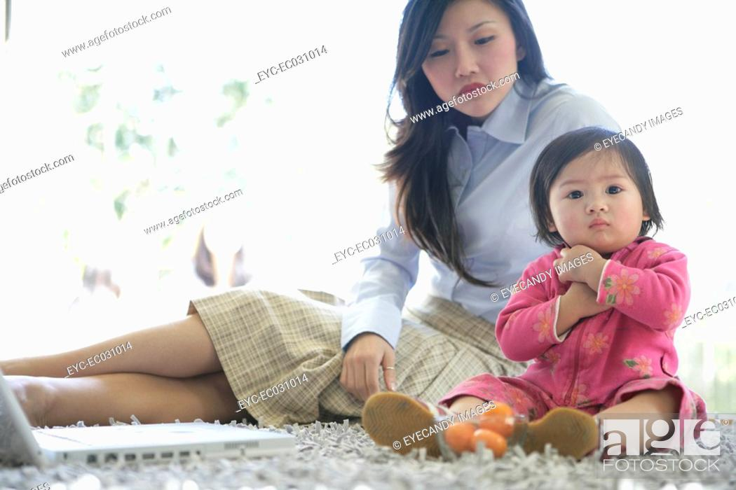 Stock Photo: Young woman with her child, front view.