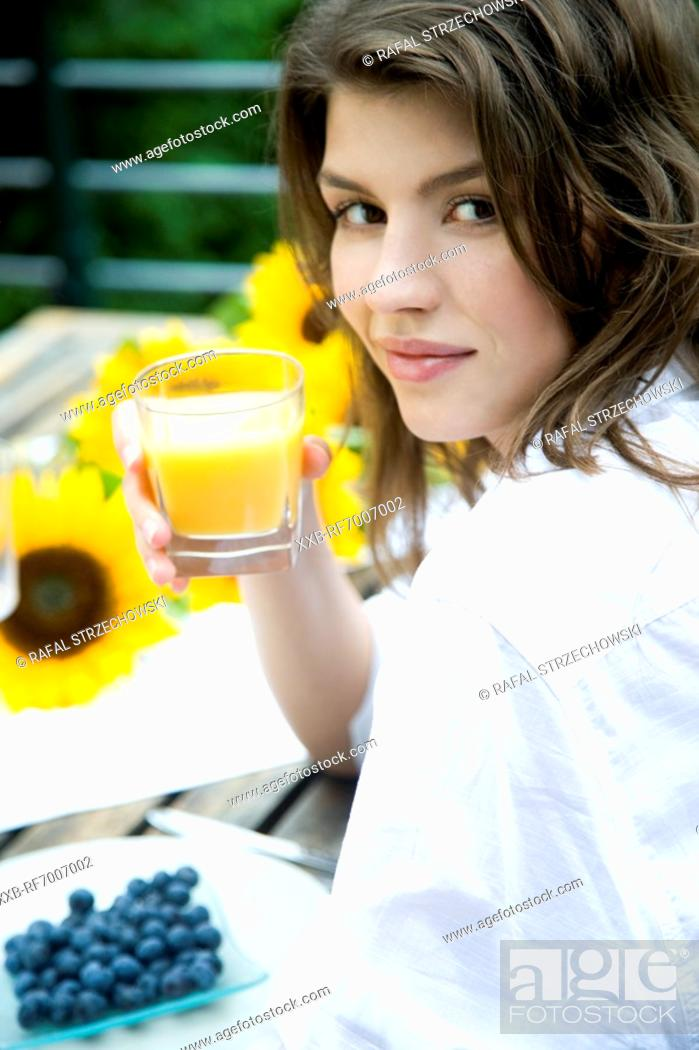 Stock Photo: Woman with glass of juice.