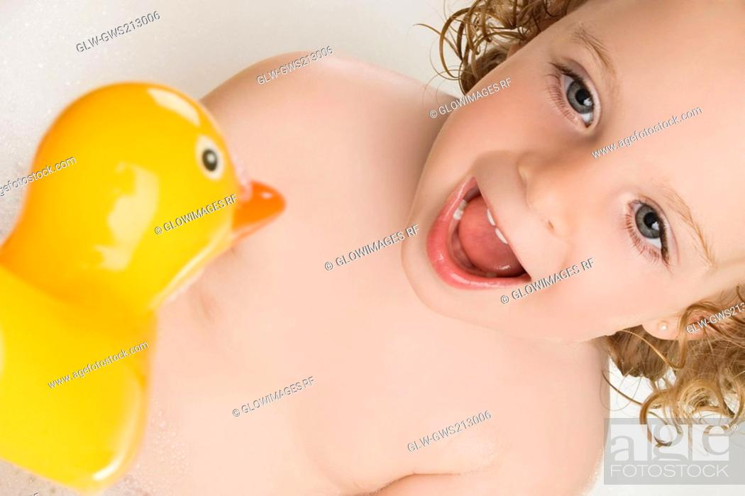 Stock Photo: Close-up of a girl with a rubber duck.