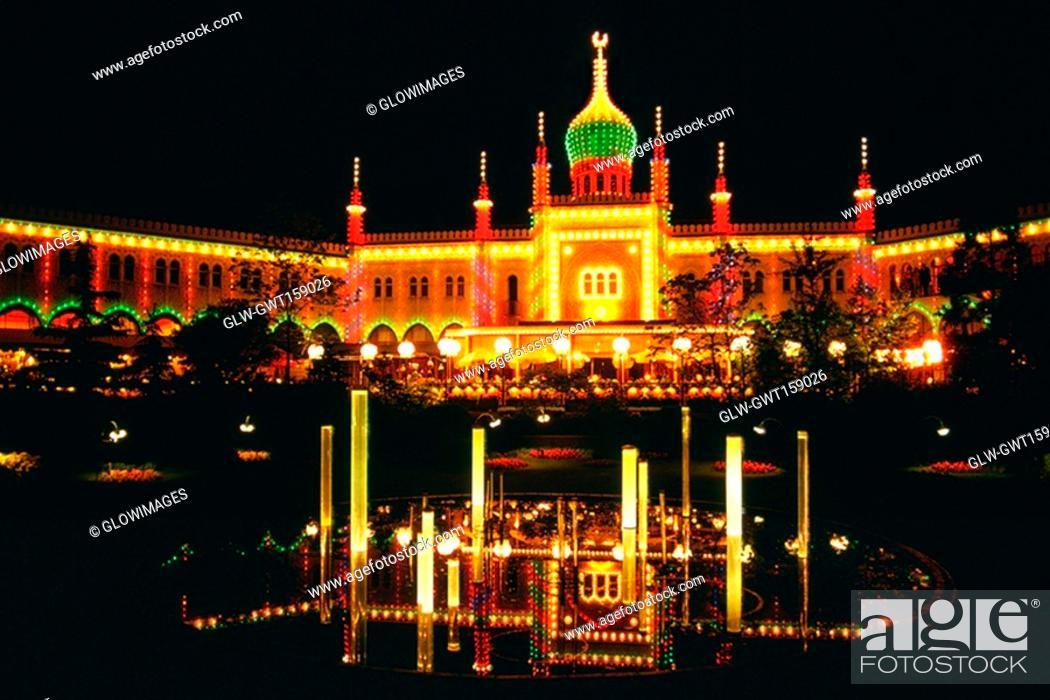 Stock Photo: Facade of a mosque lit up at night, Tivoli Gardens, Copenhagen, Denmark.