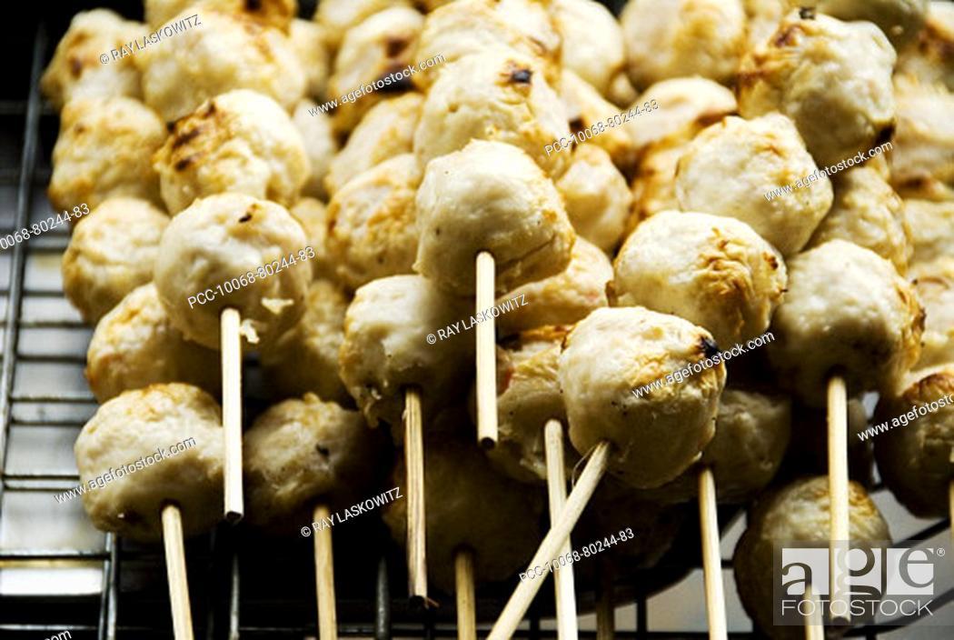 Stock Photo: Thailand, Bangkok, unusual delicacies found at street vendor food stalls, skewers of chicken meatballs.
