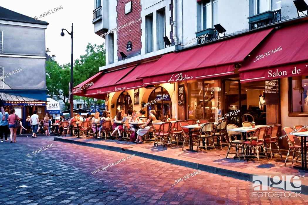Stock Photo: Outdoor Cafe on Rue du Mon Cenis, in the Montmarte Section of Paris, France. People dining and enjoying the surrounding artsy view.