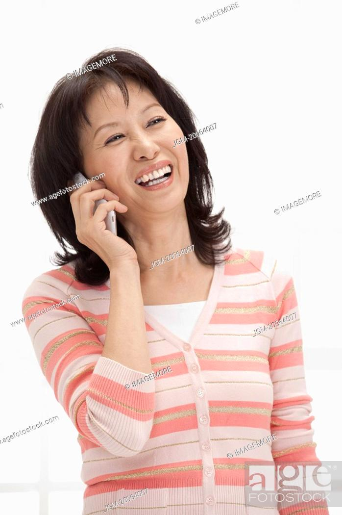 Stock Photo: Wife, Woman using mobile phone and smiling happily.