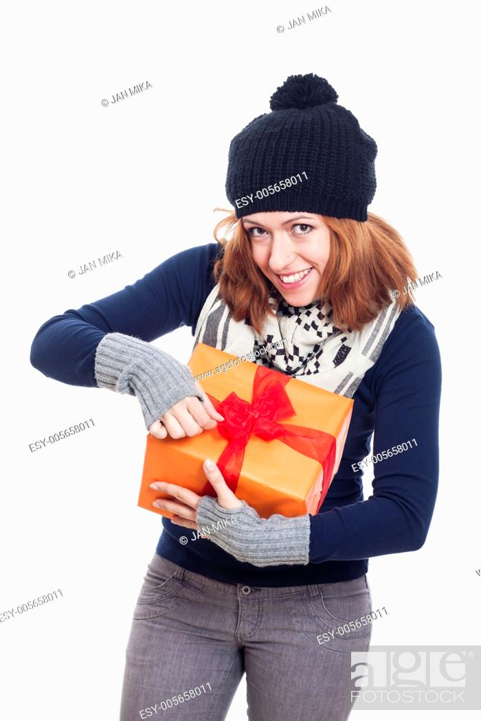 Stock Photo: Happy winter woman opening present, isolated on white background.