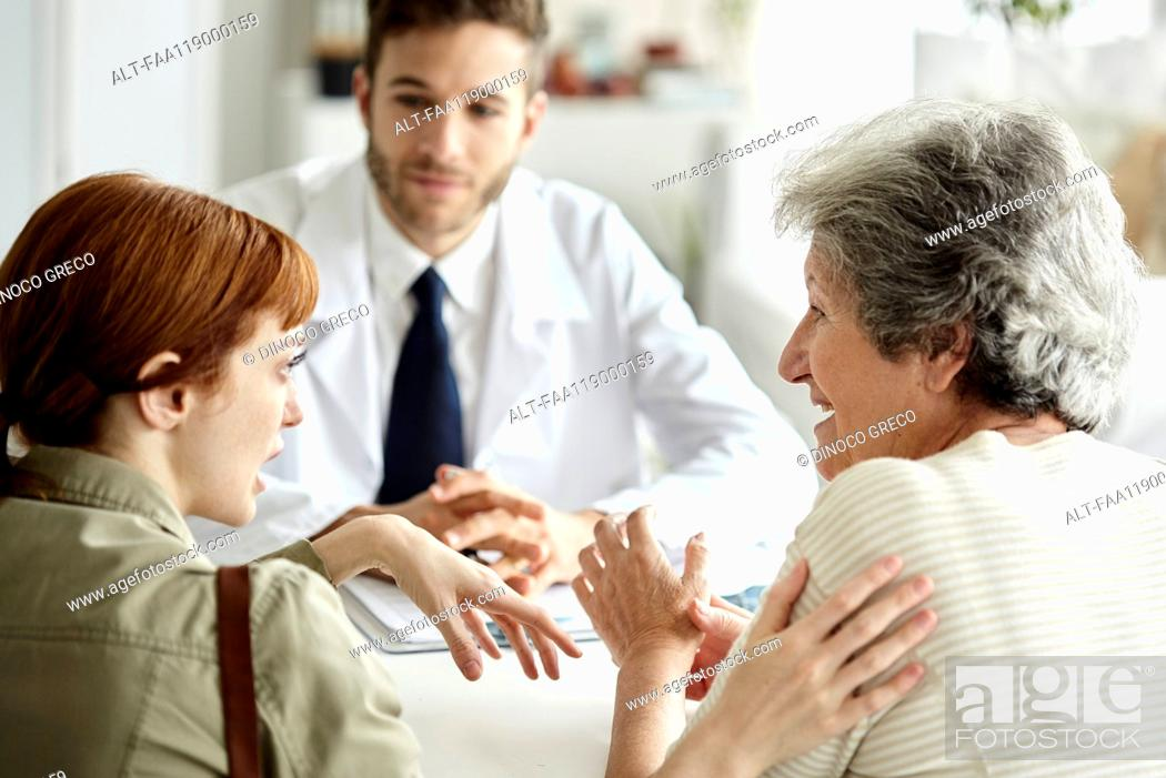 Stock Photo: Mother and daughter talking in clinic.