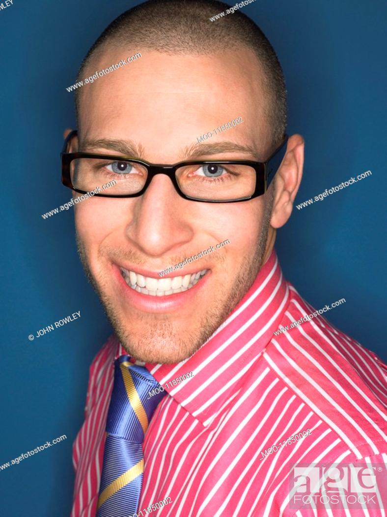 Stock Photo: Man in glasses smiling head and shoulders.
