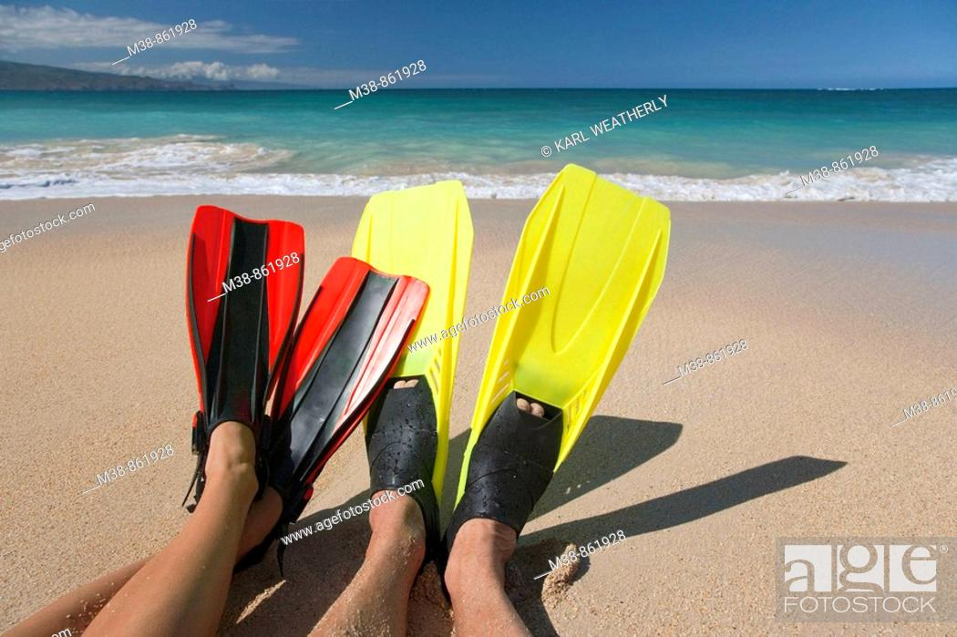 Stock Photo: Couple wearing flippers on the beach  Maui, Hawaii.