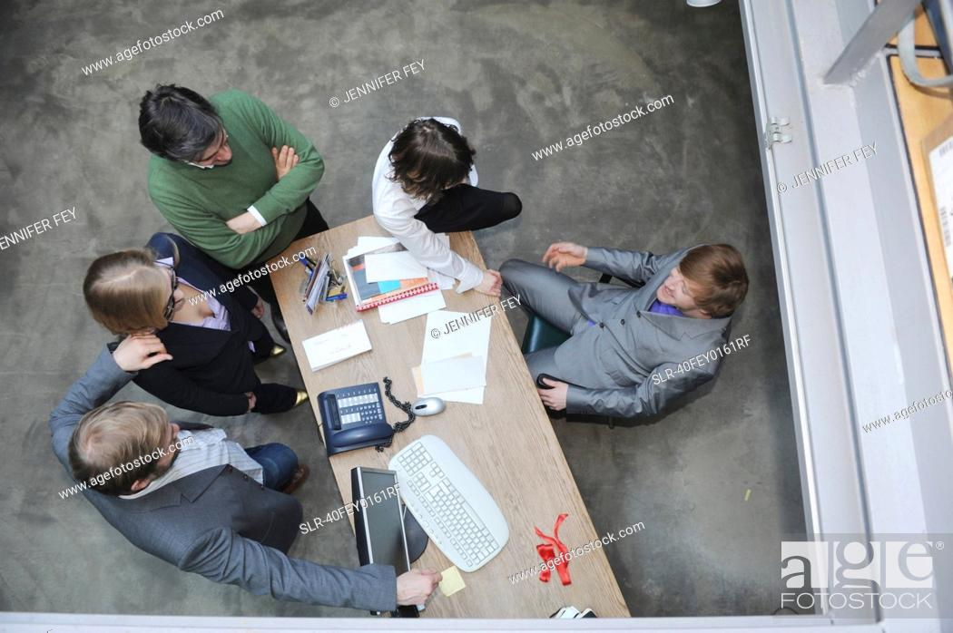 Stock Photo: Overhead view of business people at desk.