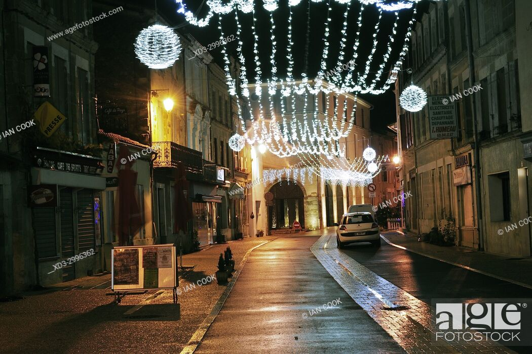 Stock Photo: village of Lauzun at night with Christmas lights, Lot-et-Garonne Department, New Aquitaine, France.