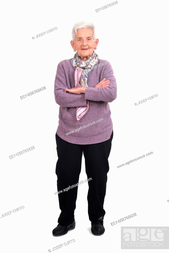 Photo de stock: full portrait of a senior woman, arms crossed, on white background.