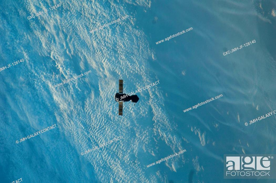Stock Photo: The Soyuz TMA-22 spacecraft departs from the International Space Station and heads toward a landing in a remote area outside of the town of Arkalyk, Kazakhstan.