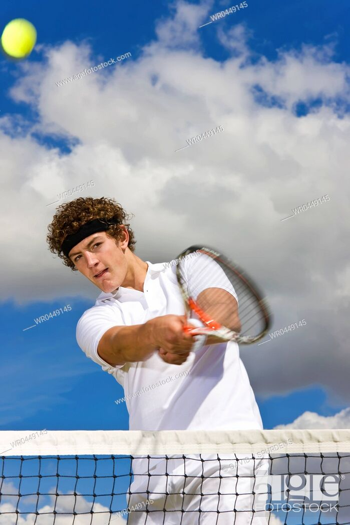 Stock Photo: A tennis player returns at the net.
