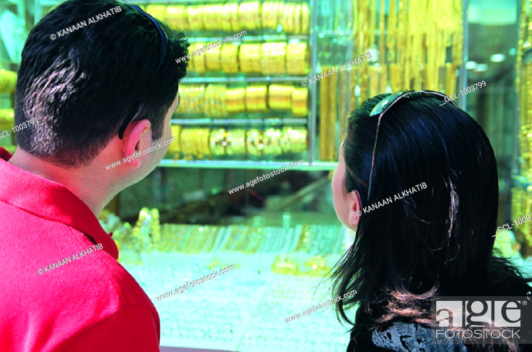 Stock Photo: Western couple looking at Jewellery display in the Gold Souq in Dubai, United Arab Emirates.