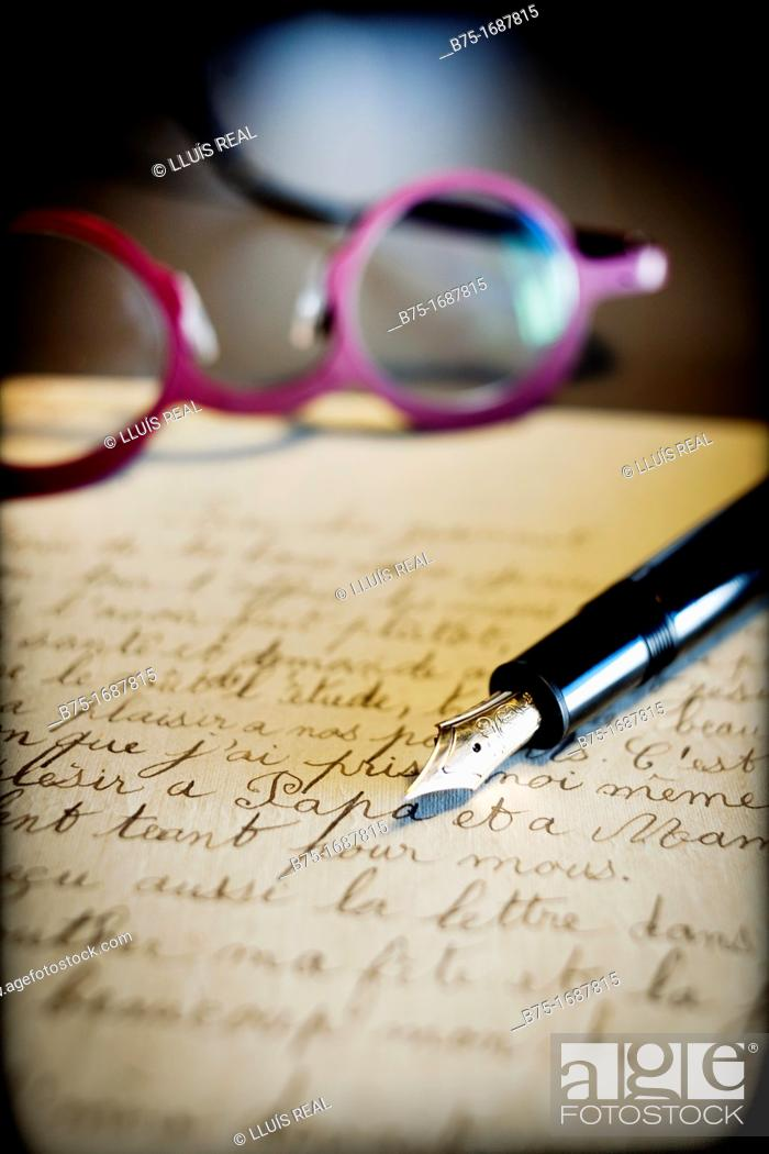 Stock Photo: old handwritten letter postmarked, pen stylographic and glasses.