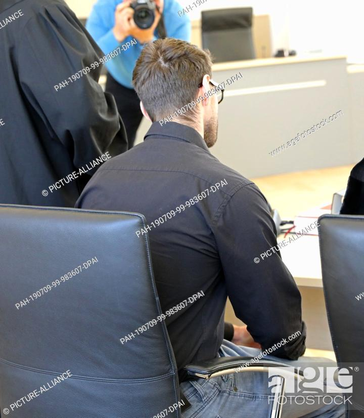 Stock Photo: 09 July 2019, Mecklenburg-Western Pomerania, Rostock: The 28-year-old defendant in the trial for attempted double homicide is waiting in the courtroom of the.
