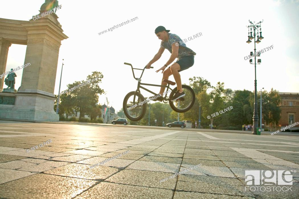 Stock Photo: BMX cyclist doing stunt, Heroes' Square (Hosök Tere), Budapest, Hungary.
