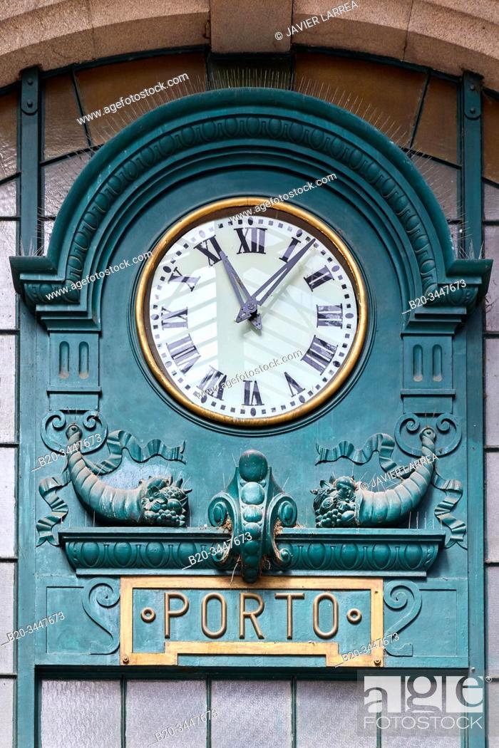 Stock Photo: Clock, Sao Bento railway station, station hall with Azulejo tiles, Porto, Portugal.