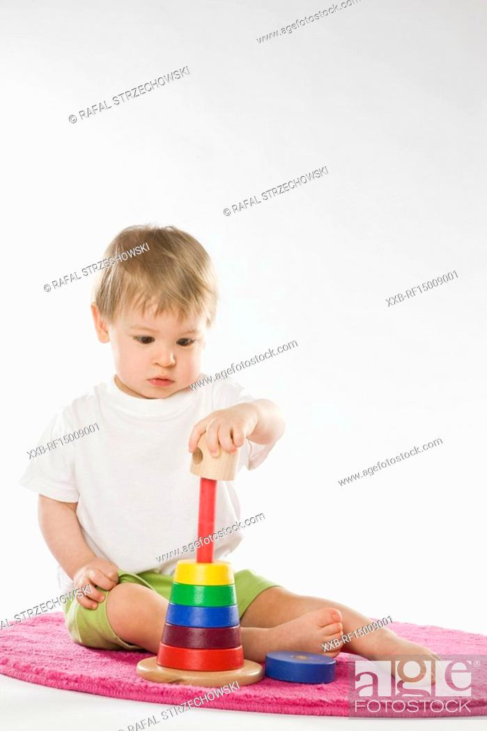 Stock Photo: baby playing with education toy.