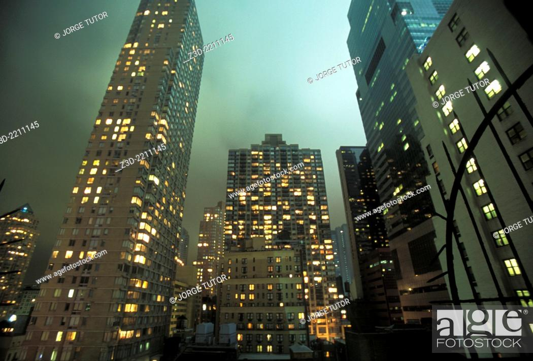 Stock Photo: Residential building in Manhattan by night. New York.
