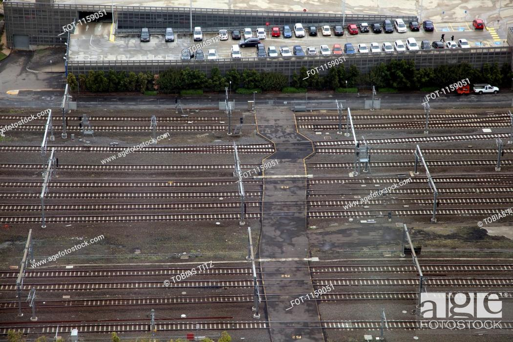 Stock Photo: Railway lines and car park.