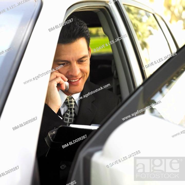 Stock Photo: Hispanic businessman talking on cell phone.