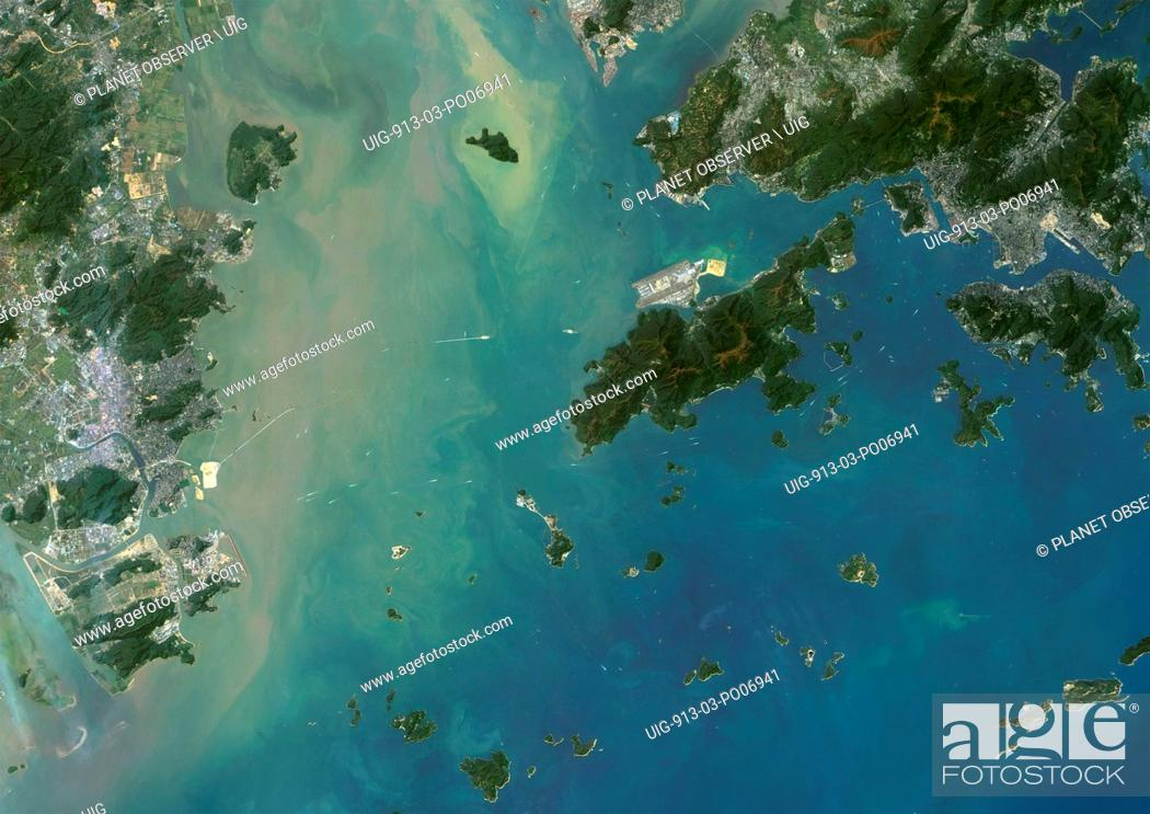 Stock Photo: Satellite view of Hong Kong and Macau. The Hong Kong–Zhuhai–Macau Bridge which consists of a series of bridges and tunnels can be seen on the image.