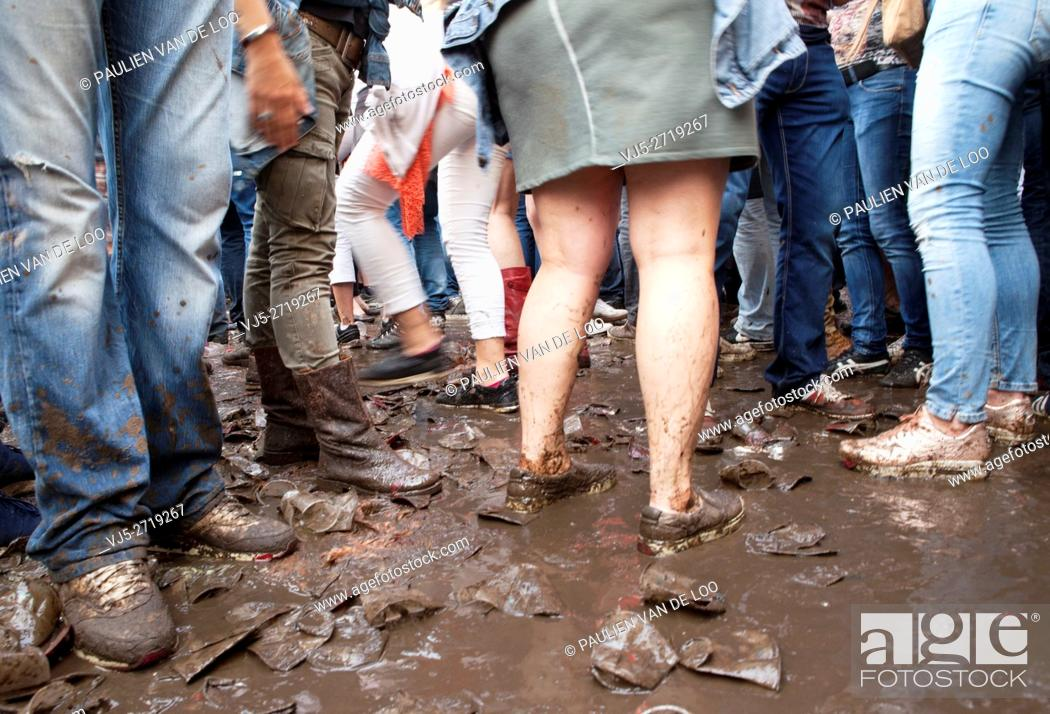 Stock Photo: Event goers defy, bust the mud at The Flying Dutch Eindhoven Event.