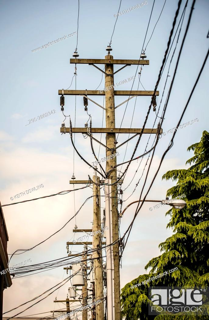 Stock Photo: Utility Power Lines in alley, Vancouver City, BC, Canada.