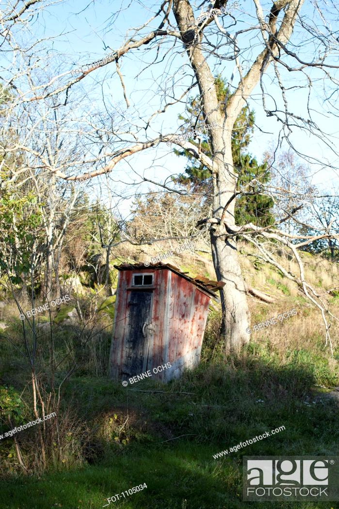 Stock Photo: An outhouse on a hill.
