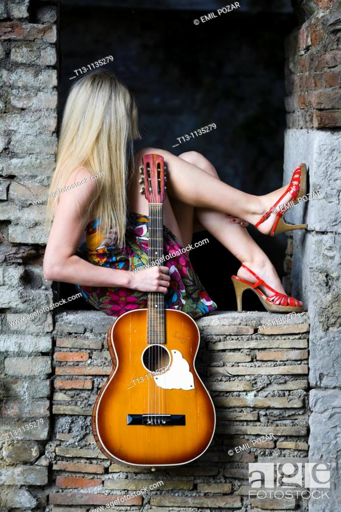 Stock Photo: Pretty woman with a guitar.