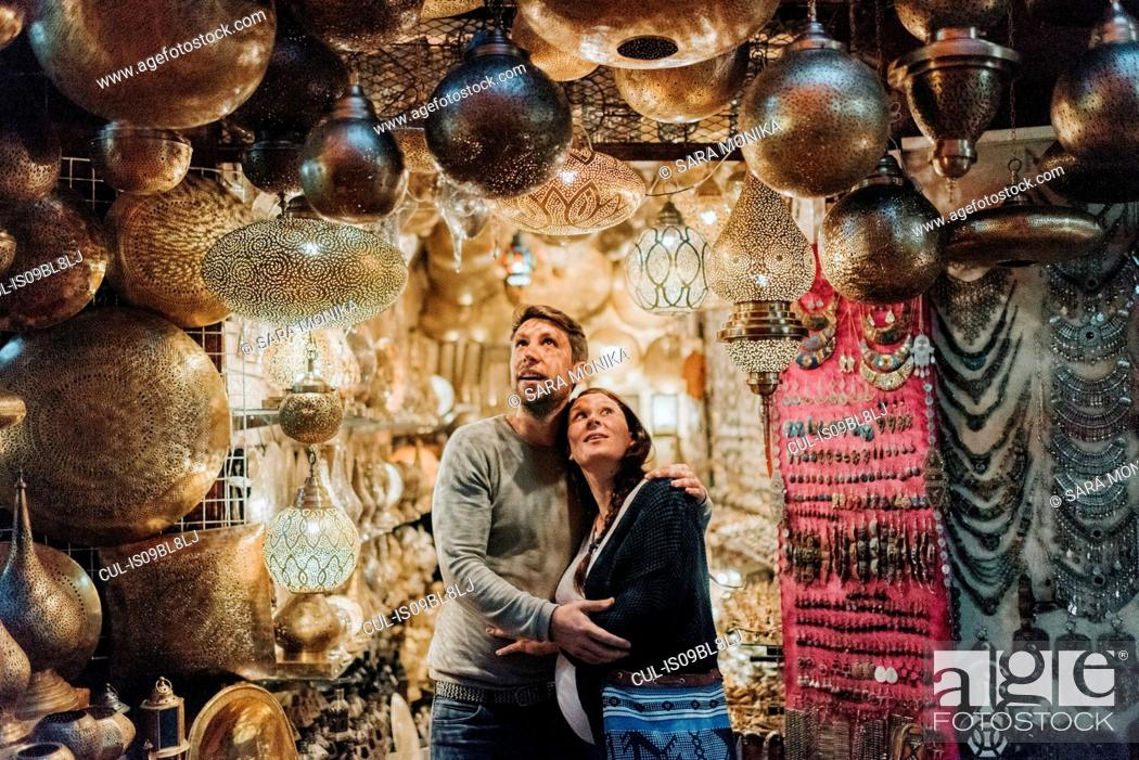 Stock Photo: Pregnant couple in souk, Marrakech, Morocco.