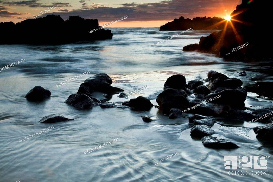 Stock Photo: Dawn light on Sumner beach seascape, Christchurch, Canterbury, New Zealand.