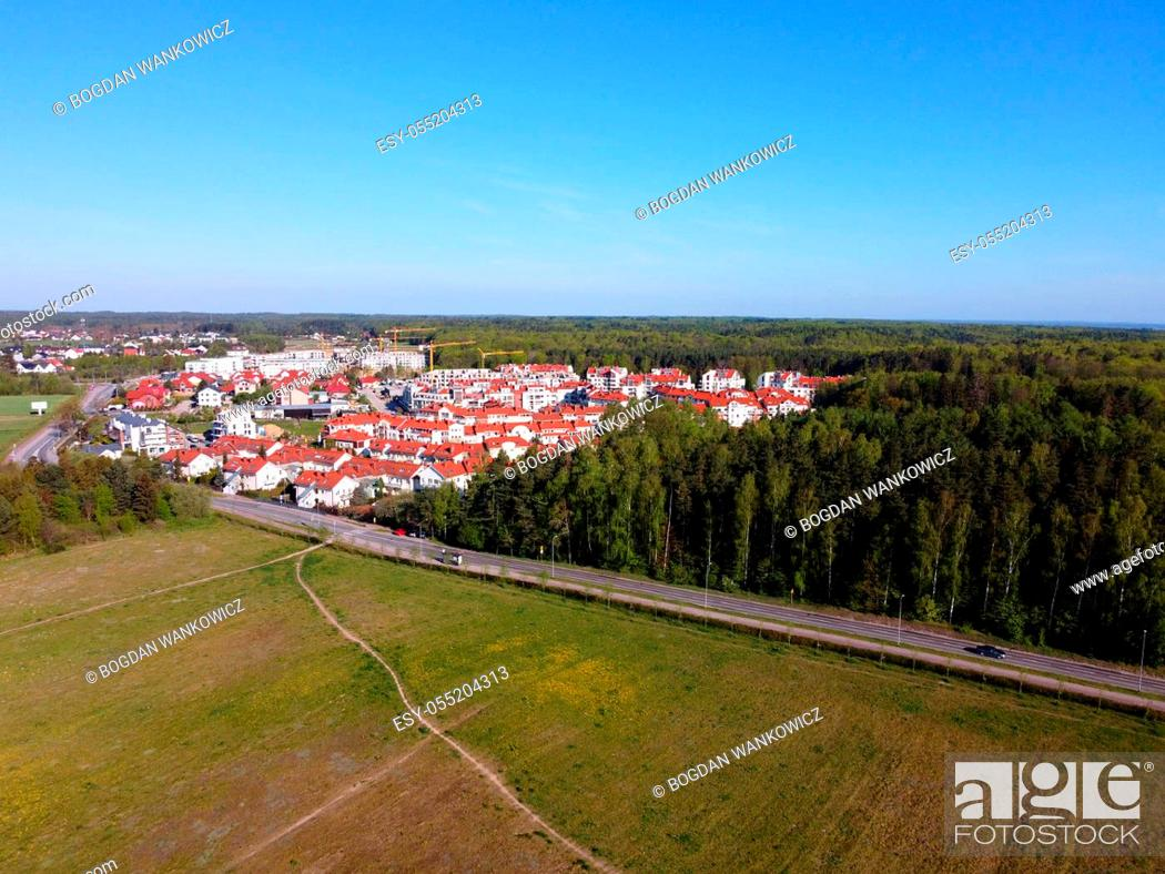 Stock Photo: New buildings of estate surrounded by fields and forests, view from a drone, Gdynia, Poland.