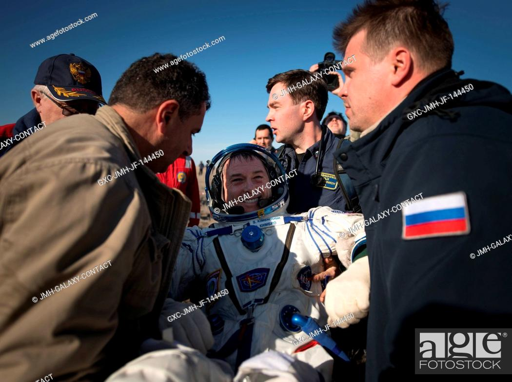 Stock Photo: NASA astronaut Shane Kimbrough is helped out of the Soyuz MS-02 spacecraft just minutes after he, Russian cosmonaut Sergey Ryzhikov of Roscosmos.