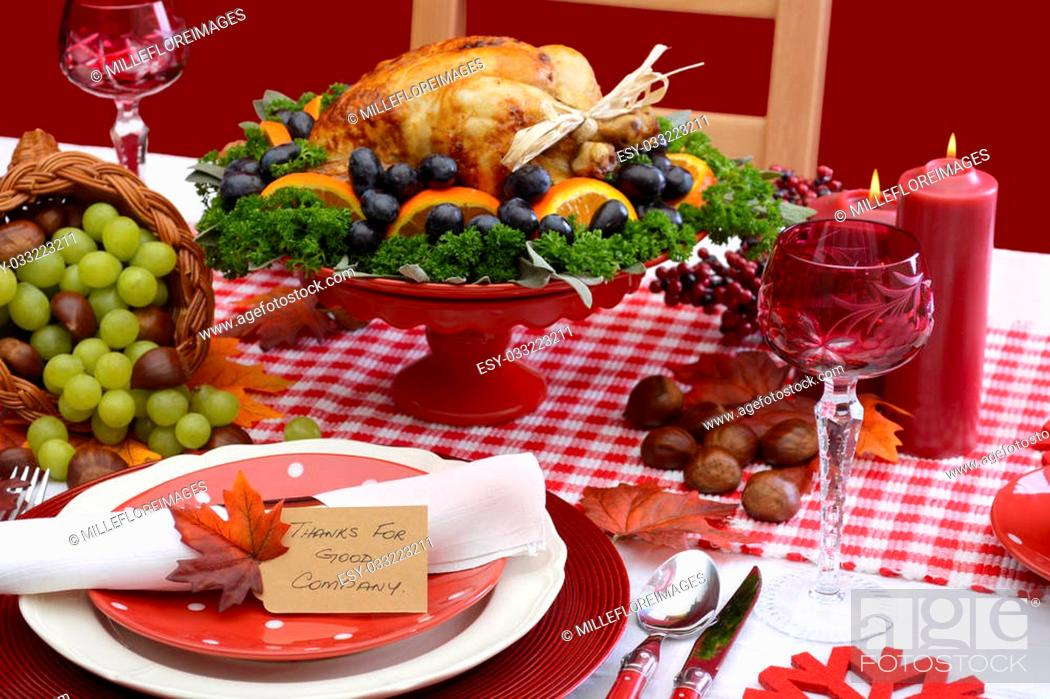 Stock Photo: Red and white theme Thanksgiving table with individual place setting, food and cornucopia.