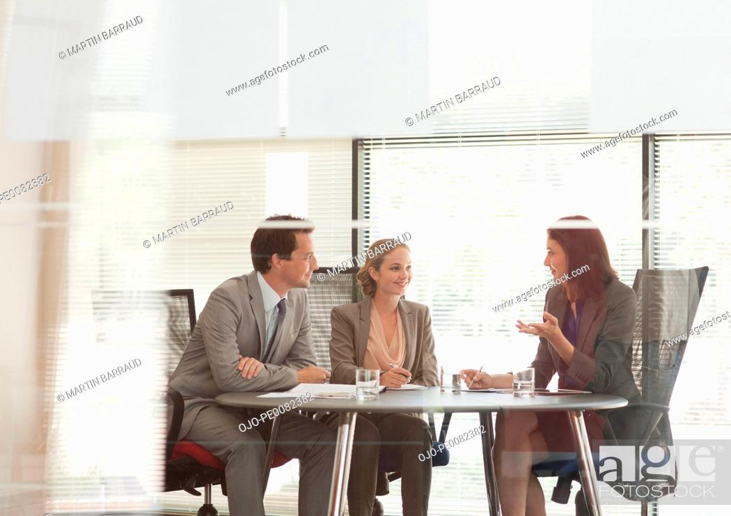Stock Photo: Business people talking at table in conference room.