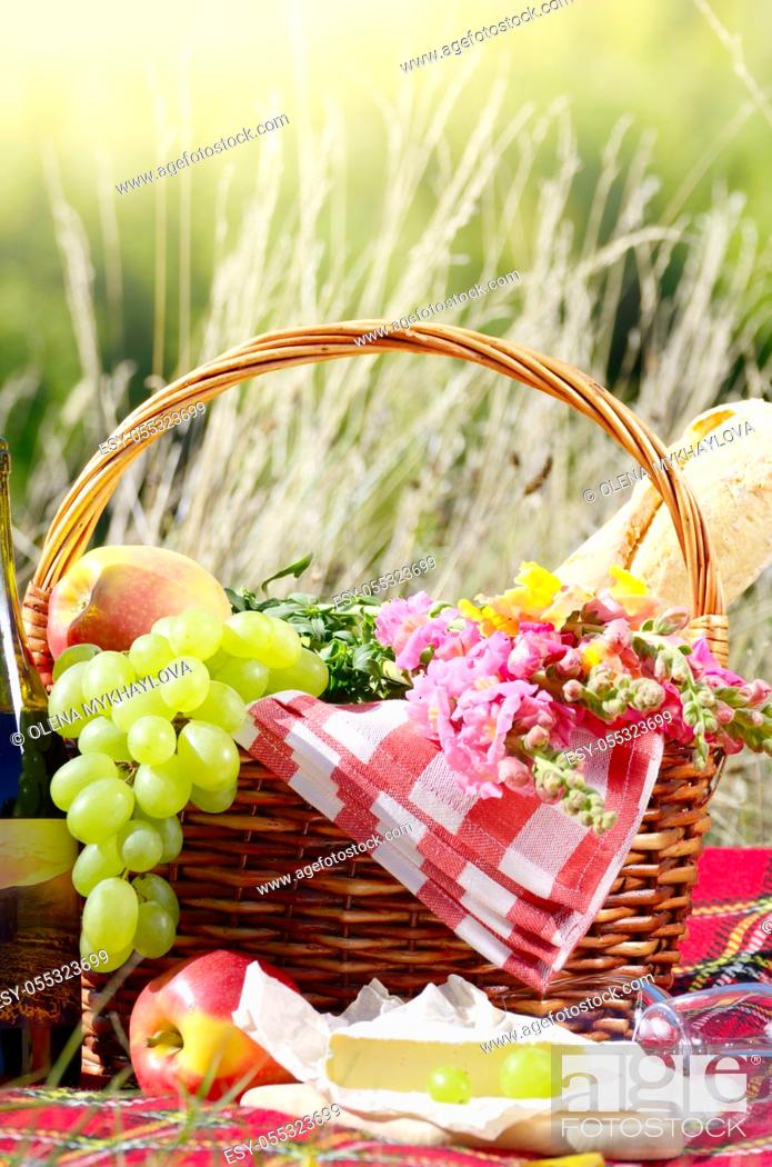 Stock Photo: Wine cheese bread and fruits - outdoor picnic concept.
