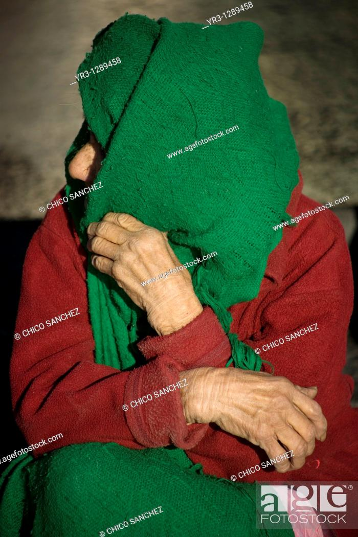 Stock Photo: An elderly pilgrim sits at the entrance of the Our Lady of Guadalupe Basilica in Mexico City. Hundreds of thousands of Mexican pilgrims converged on the.