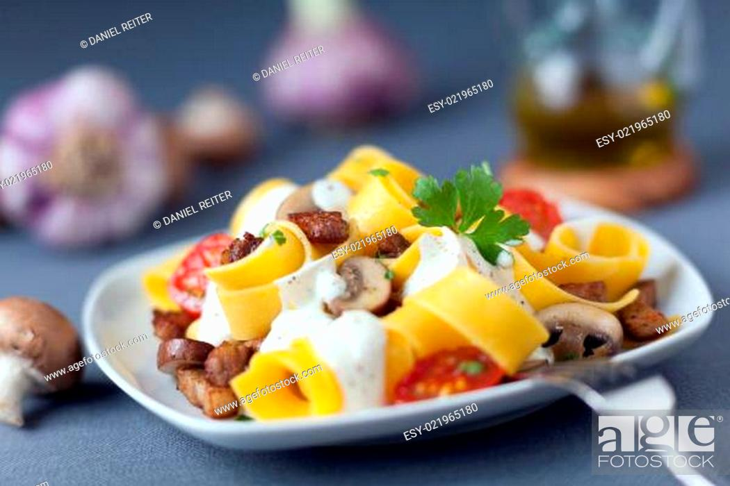 Stock Photo: Delicious Italian cuisine of pappardelle noodles.