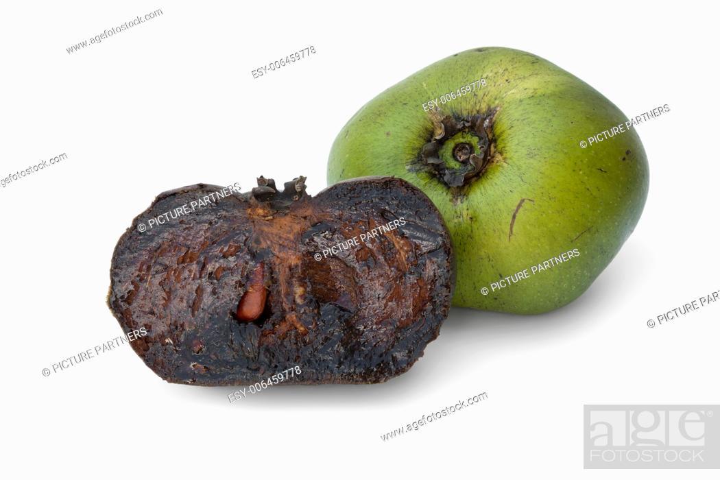 Photo de stock: Fresh whole unripe and half black ripe sapote fruit on white background.