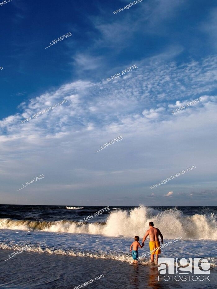 Stock Photo: Father & Son playing in the waves in , NC, USA.