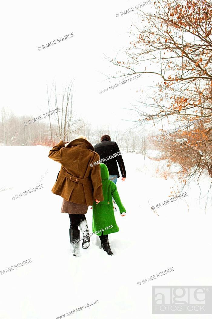 Stock Photo: Family walking in snow.