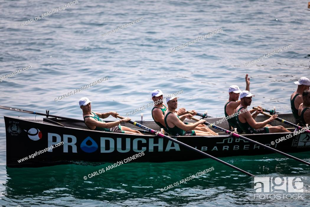 Stock Photo: CASTRO URDIALES, SPAIN - JULY 15, 2018: Competition of boats, regata of trainera, Kaiuku Producha boat in action in the VI Bandera CaixaBank competition.