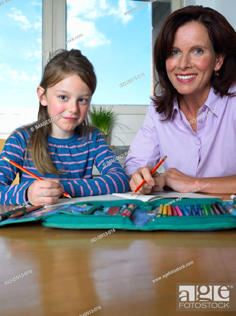 Stock Photo: Mother helping daughter with homework.