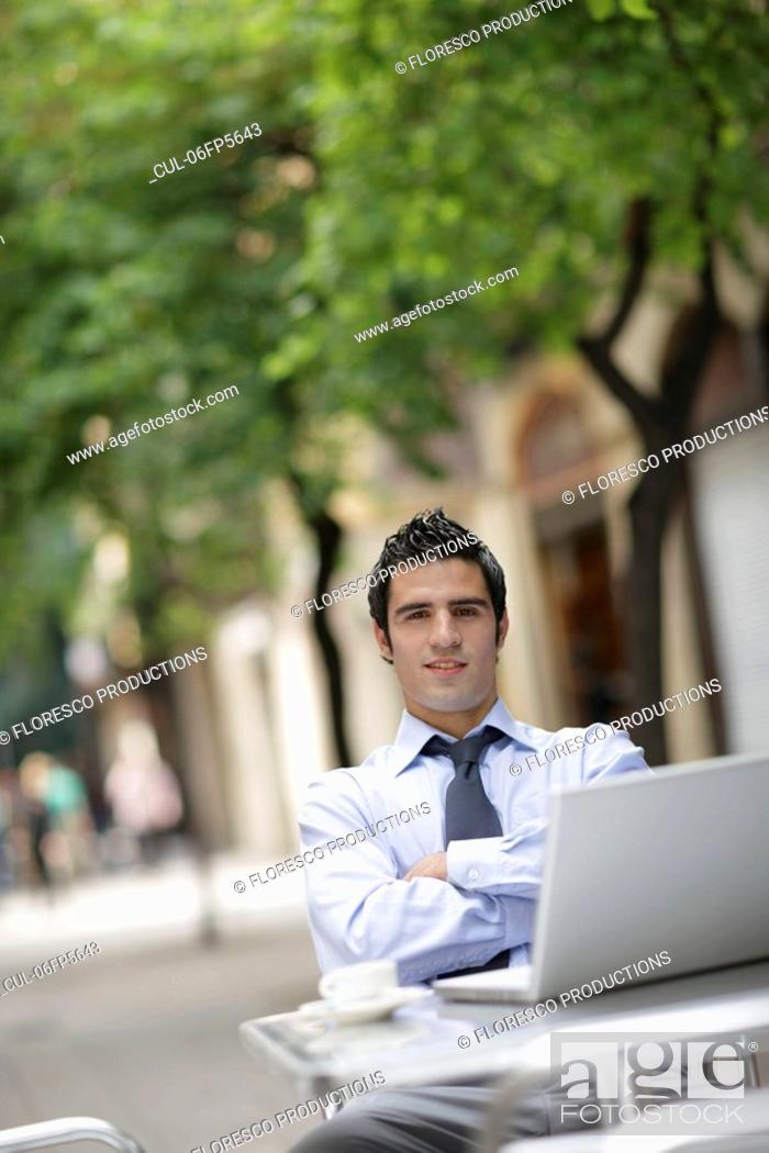 Stock Photo: Business man at café with laptop.